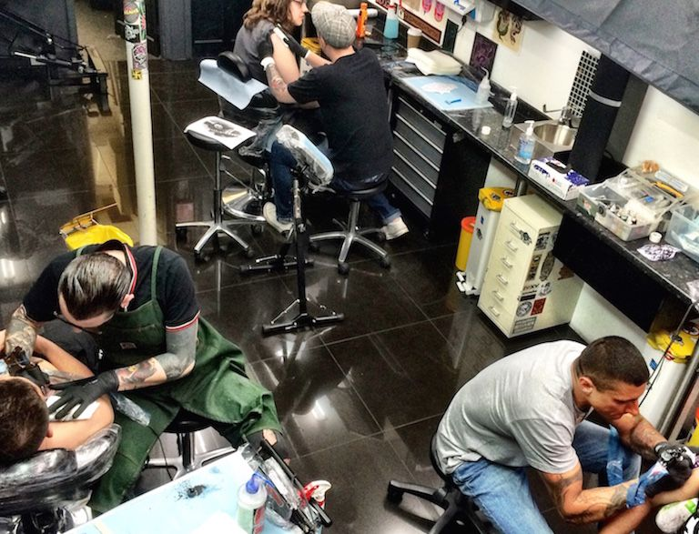 tattoo artists working at Extreme Needle Tattoo Studio